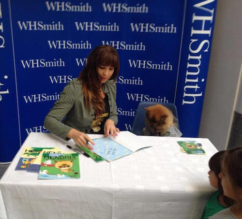 Mr Hendrix, the Pomeranian puppy who inspired a childrens' book series at a book signing.
