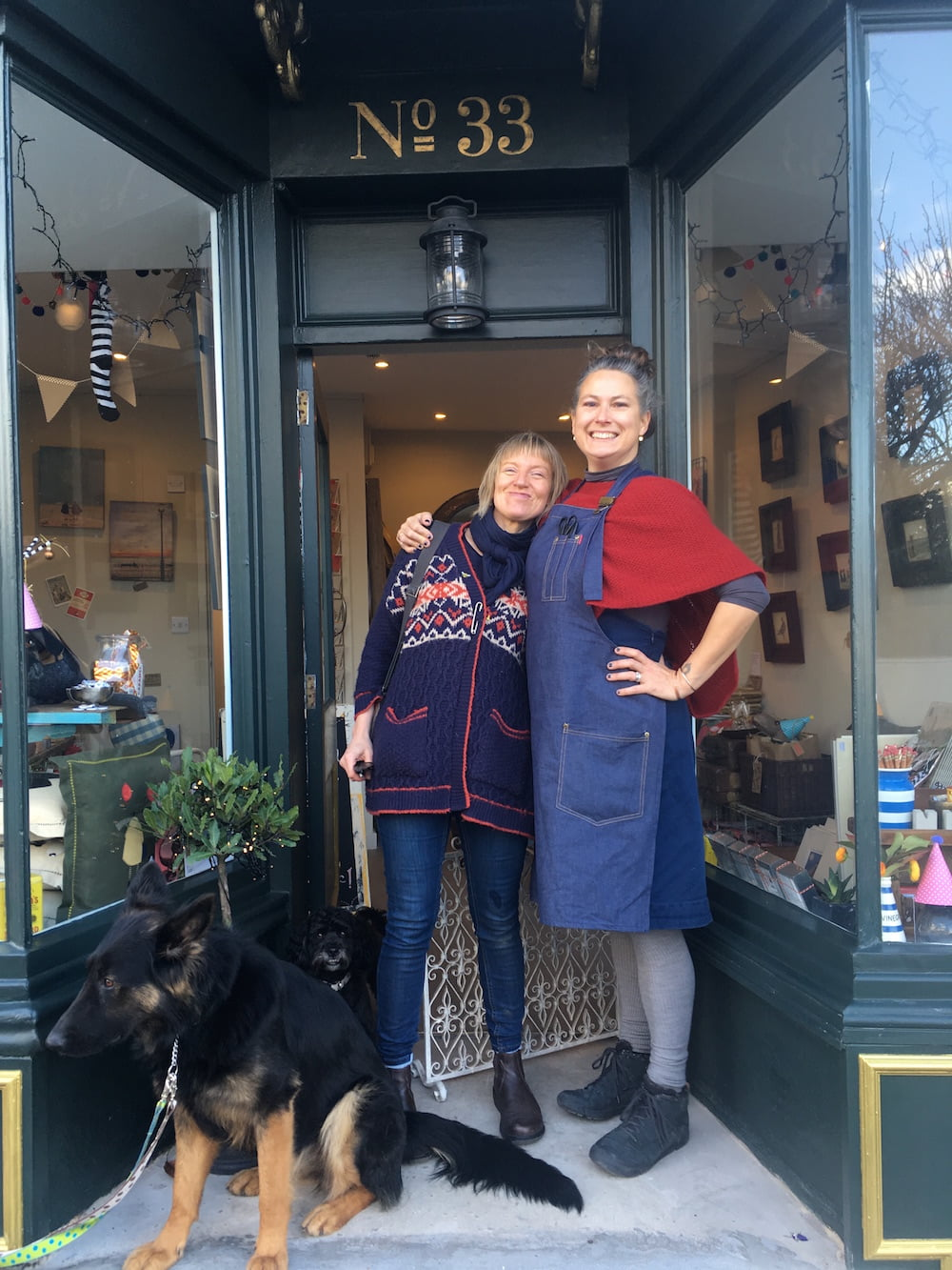 Sam Toft with her manager and friend Cadi at her Brighton shop and dogs Betty and Stan.