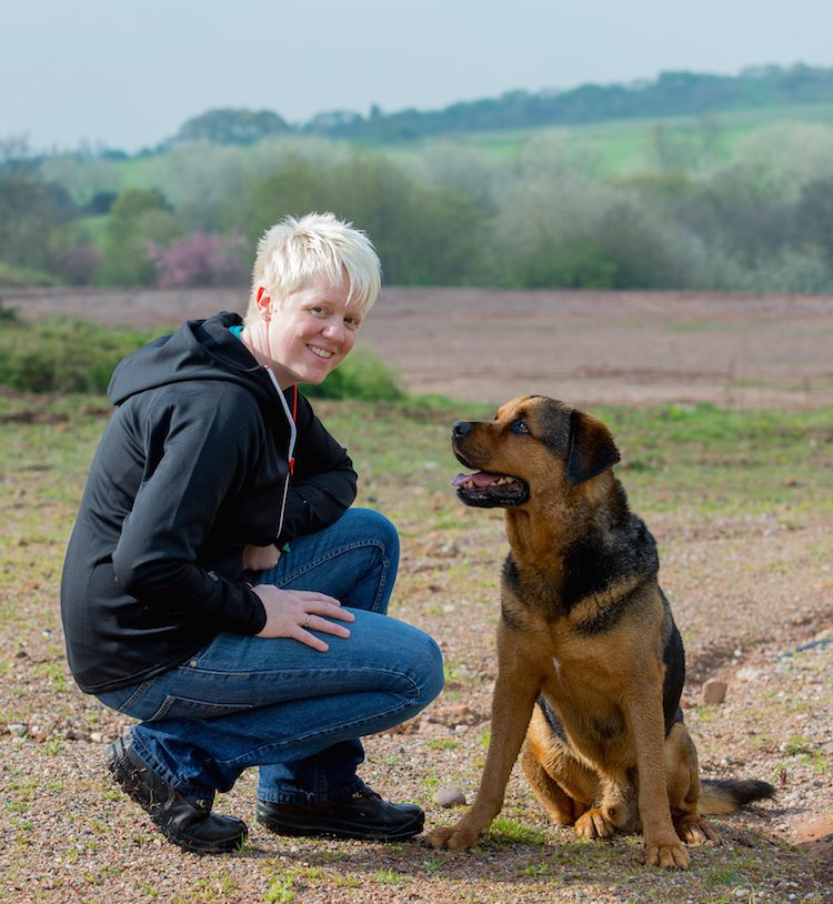 Marie, founder of Canine Hope, with Reggie, a rescue dog who inspired her novel Reggie and Me